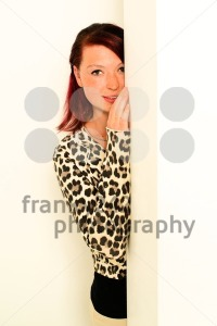 young woman peeking around the wall - franky242 photography