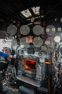 inside the cab of a classic steam locomotive with open fire - franky242 photography