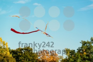 abstract colorful kite flying in blue sky - franky242 photography