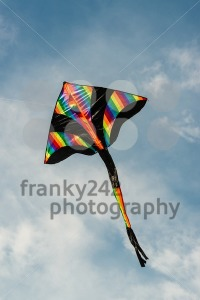 colorful kite flying in blue sky - franky242 photography