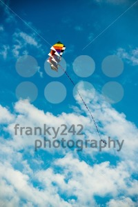 modern and colorful kite flying in blue sky - franky242 photography