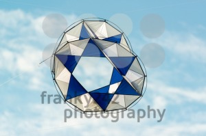 modern kite flying in blue sky - franky242 photography