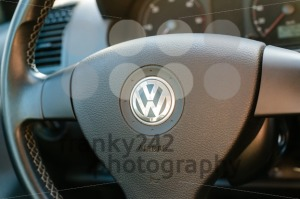 Logo of German car manufacturer Volkswagen on steering wheel - franky242 photography