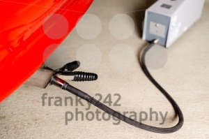 Sensor device measuring exhausts of a car in garage - franky242 photography