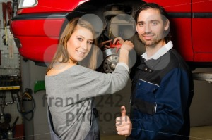 Auto mechanic and female trainee in garage - franky242 photography