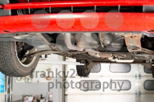 Car lifted up in garage - franky242 photography