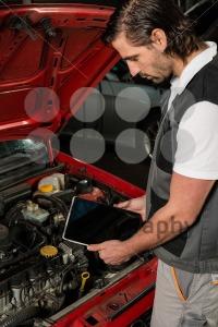 Car mechanic using digital tablet - franky242 photography