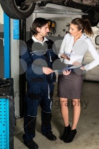 Car mechanic with angry female customer - franky242 photography