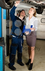 Car mechanic with female customer - franky242 photography