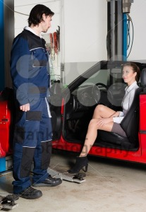 Car mechanic with female customer - franky242 photography