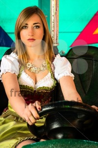 Beautiful girl in an electric bumper car at amusement park - franky242 photography