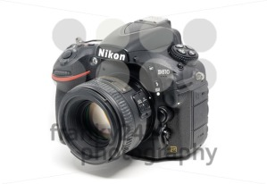 Nikon D810 camera with 50mm lens on white background - franky242 photography