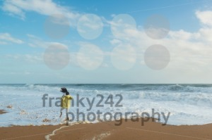 Girl jumping in the waves at beachside - franky242 photography