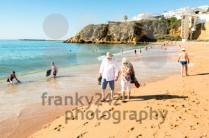 Happy senior couple walking together on a beach - franky242 photography