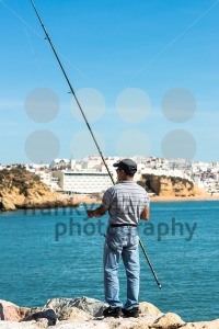 Angler on autumn sea coast - franky242 photography
