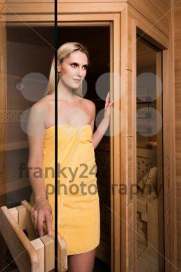Beautiful woman leaving sauna