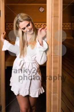 Beautiful woman leaving sauna