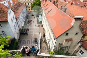 Couple making photos of the Schlossbergplatz, castle hill square, in Graz , Austria - franky242 photography