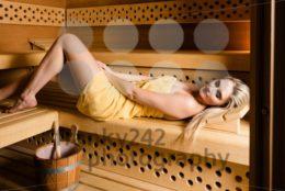 Gorgeous woman relaxing in sauna