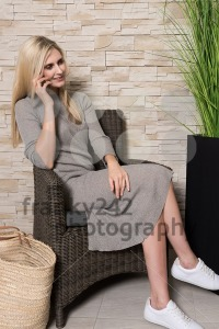Gorgeous woman talking on mobile phone in a waiting area - franky242 photography