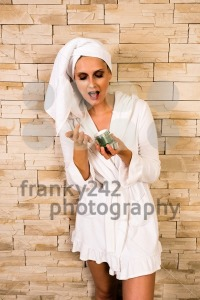Gorgeous woman using a cream jar - franky242 photography