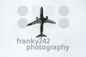 Airplane taking off during rain - franky242 photography