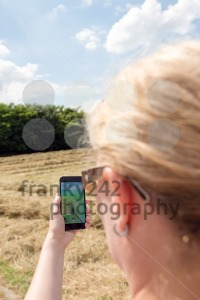 Playing Pokemon Go in the fields - franky242 photography