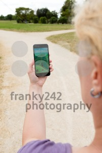 Playing Pokemon Go in the park - franky242 photography