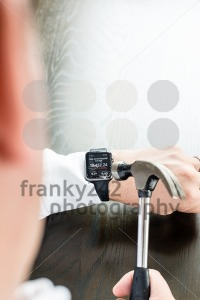 Businessman breaking Apple Watch with a hammer - franky242 photography