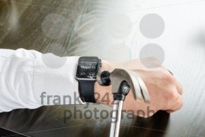 Businessman breaking Apple Watch with hammer - franky242 photography
