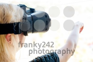 Businesswoman using virtual reality glasses in an urban environment. New technology in business (or architecture) concept. - franky242 photography