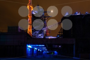 Night shot of Landschaftspark Nord, old illuminated industrial ruins in Duisburg, Germany - franky242 photography