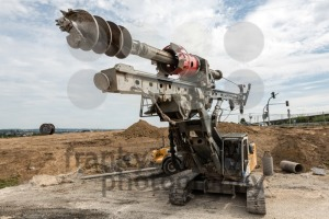 Large rotary drill and excavator on construction site - franky242 photography