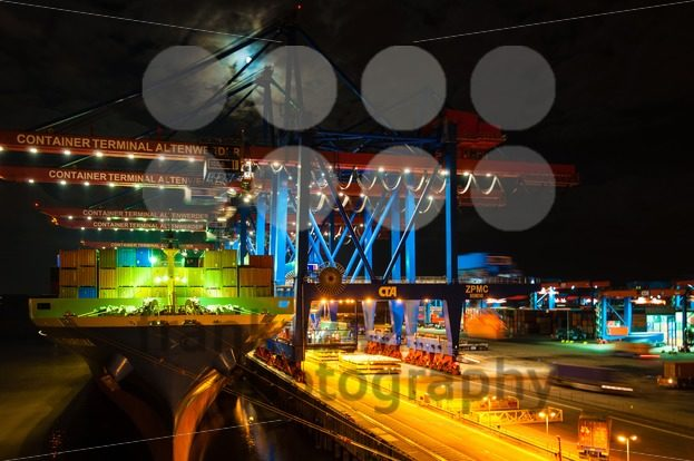 Large container ship at the Container Terminal Altenwerder in Hamburg at night - franky242 photography
