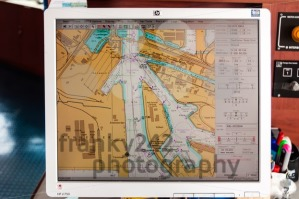 Navigation through Hamburg Harbor by map on a computer of a large container ship - franky242 photography