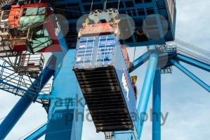 Sea container lifted by a harbor crane - franky242 photography