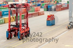 Straddle carrier serving containers at the Buchardkai Container Terminal in Hamburg - franky242 photography