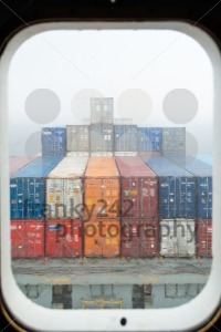 View throught the porthole of a container ship - franky242 photography