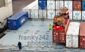 workers supervising container uploading at dock - franky242 photography