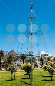 Christmas tree beside the sea in Cape Town, South Africa. Lion's Head mountain on the background. - franky242 photography