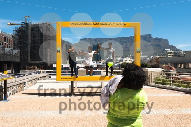 People having fun at the Table Mountain photospot at the Waterfront in Cape Town - franky242 photography