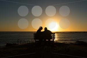 Seniors couple enjoying colorful sunset - franky242 photography