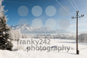 Austrian Winter Wonderland with mountains, a power pole, fresh snow and haze - franky242 photography