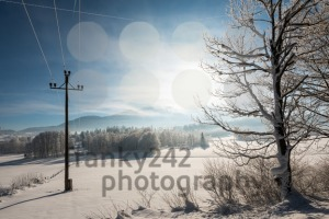 Austrian Winter Wonderland with mountains, a power pole in fresh snow and haze - franky242 photography
