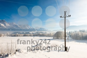 Austrian Winter Wonderland with mountains, fresh snow and haze in the sunlight - franky242 photography
