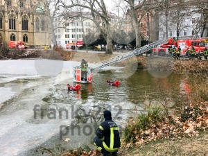 Exercise of rescuing a man breaking into frozen lake in winter - franky242 photography