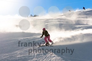 Female skier in fresh powder snow and sunlight - franky242 photography