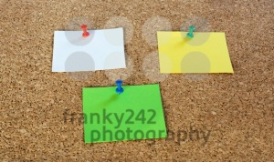 Thumbtack pins and notepaper on pinboard - franky242 photography
