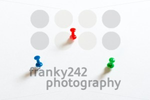 Thumbtack pins on white - franky242 photography