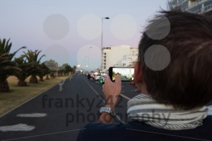 Caucasian Man is filming the supermoon in Cape Town - franky242 photography